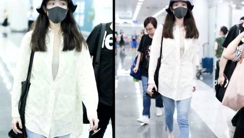 倪妮机场穿搭,淡黄色衬衫加八分牛仔裤随性舒适