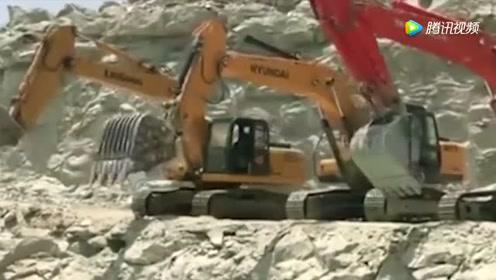 这是挖掘机开工前,伸展运动吗?
