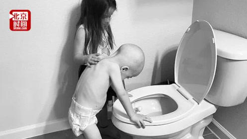 美国四岁男童血癌化疗后呕吐 五岁姐姐轻抚弟弟独自清理秽物