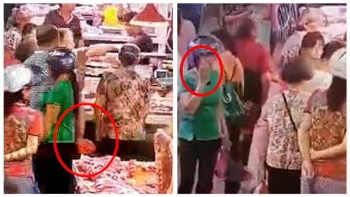 猪肉太贵吃不起?网曝广西一女子菜市场偷猪骨,佯装打电话逃离