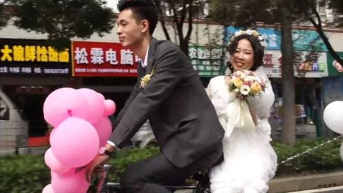 小伙骑共享单车当婚车迎亲 新娘一脸幸福称很浪漫