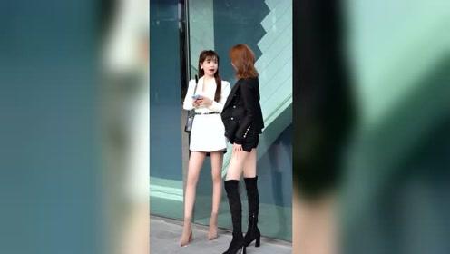 果然还是黑色长靴比较显腿长,白色衣服小姐姐转头就走