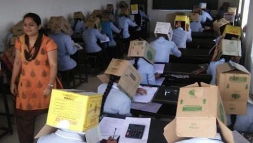 印度学校为防作弊出奇葩招数 让考试生头顶纸盒进行考试