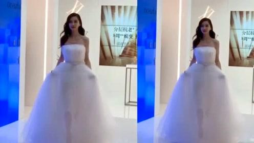 杨颖穿婚纱现身活动,现场有上百位保安,前后三层护送