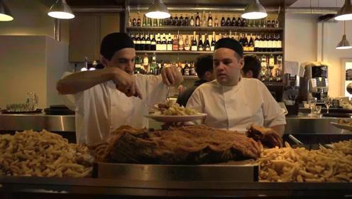 吉尼斯纪录最大的炸鱼排,需要全店人员抬它上桌