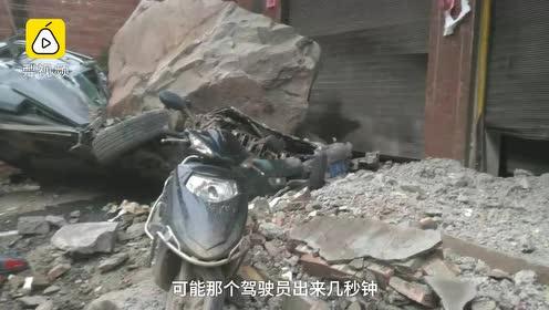 云南山石滚落砸扁汽车,新房被砸出窟窿,路人提前1秒撤离