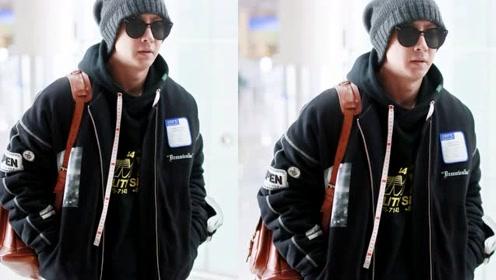 韩庚懒理结婚传闻现身机场 黑超遮面装扮酷帅变潮男