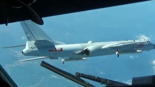 大国风范!空军首次曝光:轰6K战机在国际空域排除外机干扰画面