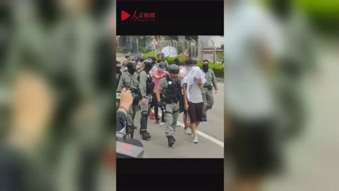 理大黑衣人排队接受警方调查,止暴制乱,香港才有未来