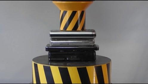 老外将手机放在液压机下,网友:土豪就是任性!