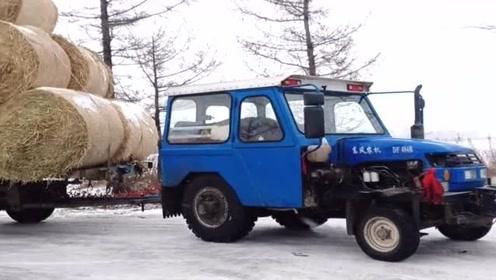 现在的拖拉机越做越人性化了,还知道安装个驾驶室,冬天一点也不冷了!