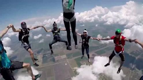 惊险花式跳伞:多名跳伞队员空中牵手组圈等一人跃入