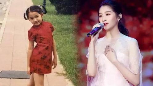 关晓彤晒6岁拍奥运宣传片时旧照,穿红色旗袍的她从小就是大长腿
