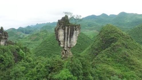 云南深山发现一奇石,悬立深崖千万年不倒,走近一看却呆了