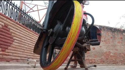 小伙真大胆,10000根橡皮筋缠在摩托车轮胎上,会发生什么?