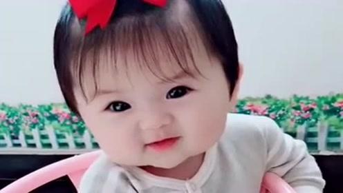 这个小宝贝真可爱,圆溜溜的大眼睛,很漂亮!