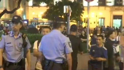 污蔑香港警方的黑衣人跑澳门搞非法聚集,看到警察落荒而逃……