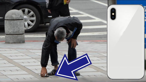 超牛绘画大师街头恶搞,在马路上画了一个手机,路人纷纷中招