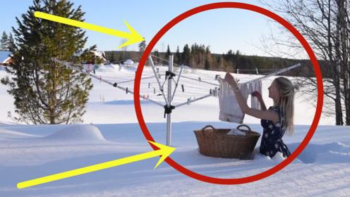 人越漂亮越不怕冷吗,看美女穿裙子在雪地里晒衣服,这得多大勇气啊!
