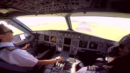 男机长驾驶飞机平稳降落,女副机长在一旁学习,真让人羡慕