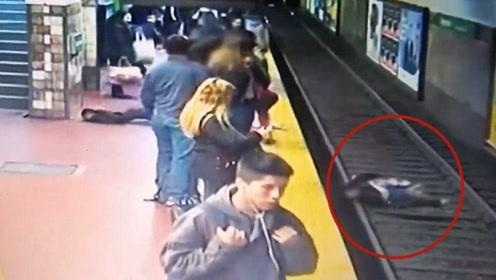 幸好刹车及时!监拍:列车即将进站 男子突然晕倒把女子撞进铁轨