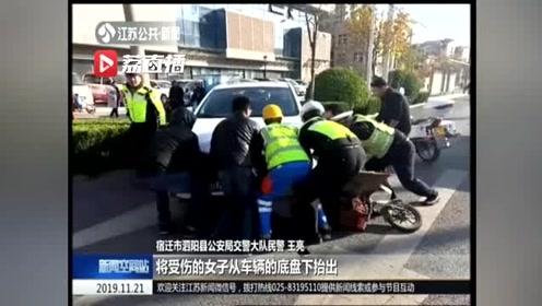 暖心!女子被撞卷入车底动弹不得 众人合力抬车救人