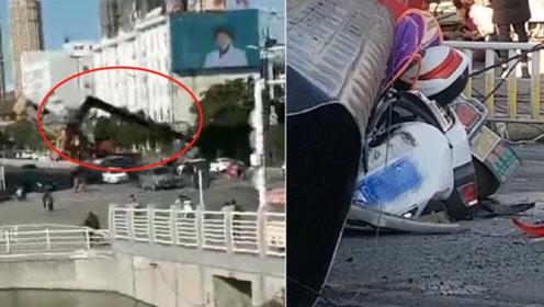 电视塔拆除时吊车起重臂突然断裂致1死2伤 路人拍下倒塌瞬间