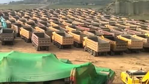 看看这有多少辆货车,你就知道我们老板多有钱!