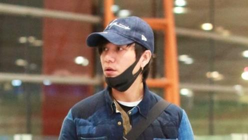 陈坤穿拼色棉服现身机场文艺范十足 获粉丝一路跟随
