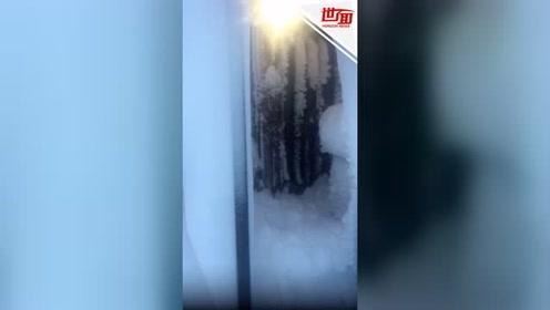 冰岛的雪有多大?主人出去发现房子被埋了找不到门了