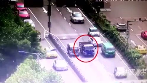 违法货车见交警检查 竟在滚滚车流中逆行