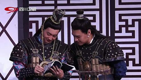 朱天福卜钰看着《葫芦娃》讨论兵法,煞有介事的样子很尴尬