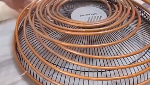 在风扇上缠满的铜管,效果不比空调差,简直就是天才般的发明