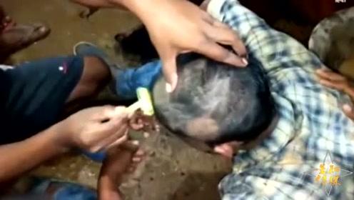 印度女子与邻村男孩恋爱遭村民反对 双双被剃光头发