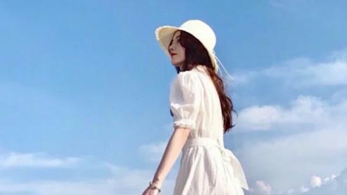鞠婧祎晒度假美照,穿白裙漫步海边宛若小仙女,风景不及你半分美
