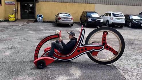 用木头制作三轮车,喷上漆后,看起来还有点酷