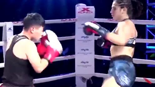 中国拳手苦苦鏖战最终被一脚KO,半天起不来身,外国美女好厉害