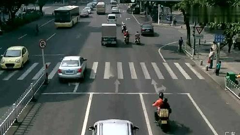江门:大人闯红灯横穿马路 小孩学样被撞倒