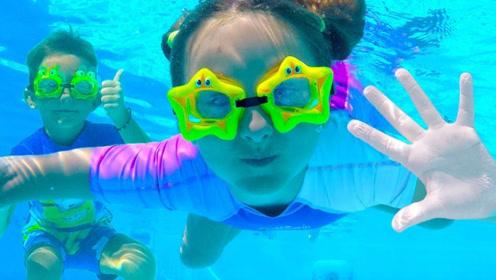 女孩在泳池中游泳渴了,妈妈把饮料放救生圈上,随时可以喝!