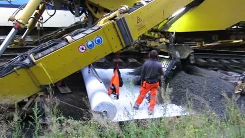 修建铁路的大型机器,很少要人工插手