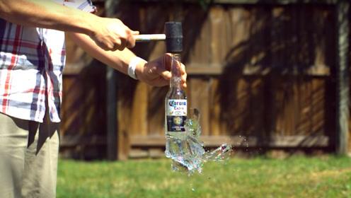 怎样可以做到拍玻璃瓶口使底部碎裂?老外练习, 网友:手掌快废了吧