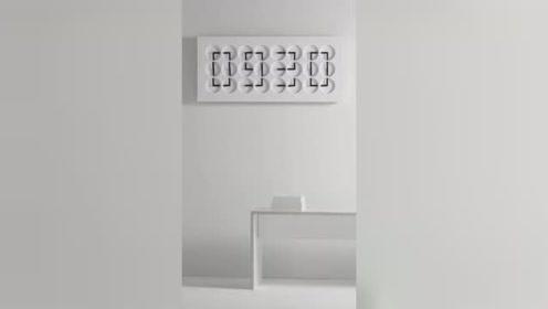 这是一台可展现时间形状的大时钟,由24个小时钟组成