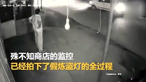 印度一笨贼为偷灯泡 清晨在商店门口假装健身