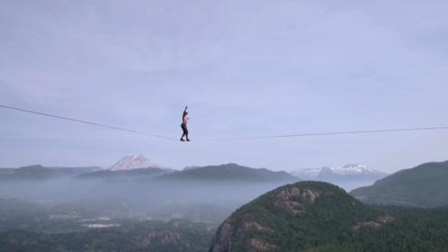 两高山之间走绳索挑战世界记录,看的让人胆战心惊啊