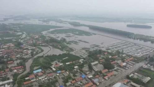 黑龙江讷河洪水淹村庄,大娘被迫撤离:啥都没拿出来,回不去了