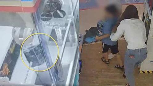 女子教唆男孩偷自动贩卖机,还直夸聪明,监控拍下全程