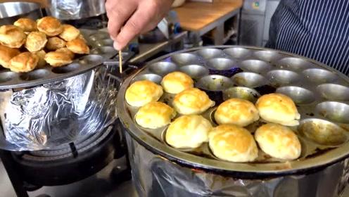 伦敦街头的特色小吃,店员现场制作小煎饼,看起来像泡芙一样美味