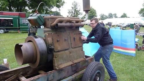 手摇式四缸老式柴油发动机,老外现场启动,网友:这么久还能用?