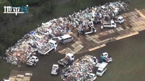 """台风过后日本灾民排起长队扔""""灾难垃圾"""": 分类严格 往返多次"""