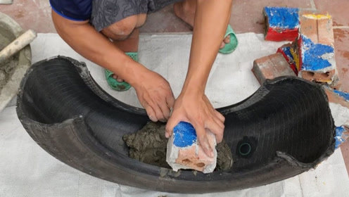 水泥放在轮胎里面,刚开始都看不懂,成品出来后我佩服了!